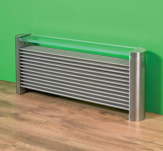 New Yorker stainless steel radiator against green wall