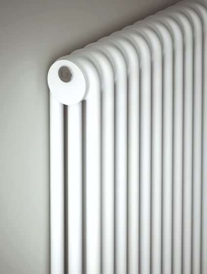 Close-up of Kiclos 3 column radiator in white