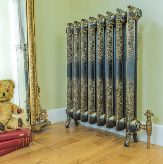 Rococo ornate cast iron radiator in burnished gold finish