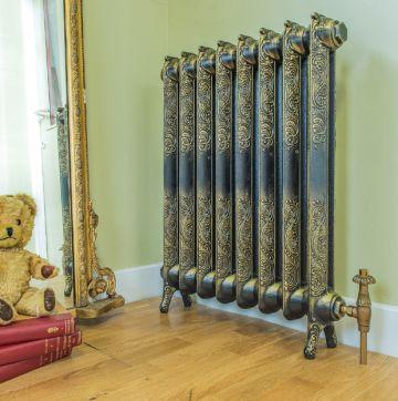 Rococo ornate cast iron radiator in burnished gold finish
