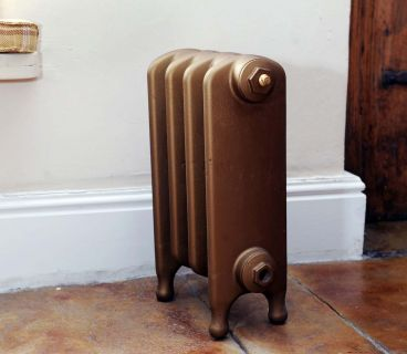 Thackray 440mm high cast iron radiator in Guinea Gold