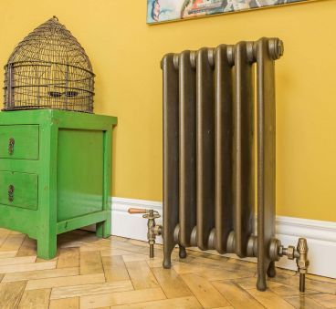 Thackray 740mm high cast iron radiator in Farthing