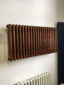 Colori column radiator in copper lacquer