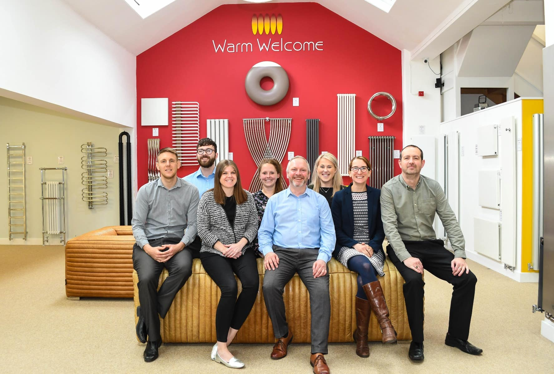 The Feature Radiator team sat in the showroom